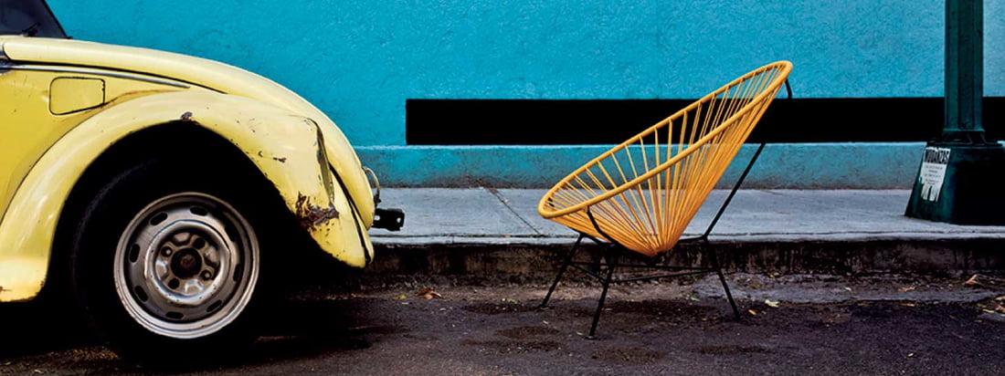La Chaise Acapulco d'Acapulco Design se distingue par son assise d'exception en cuir. La chaise rétro confortable est fabriquée à Mexico.