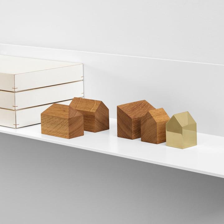 Maisons AC10 de formes et matériaux différents
